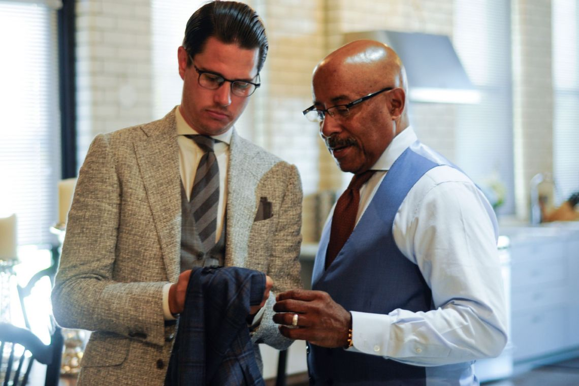 Car designer Ed Welburn with his tailor Clements and Church