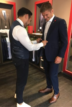 England's Owen Farrell being fitted for a Clements and Church suit